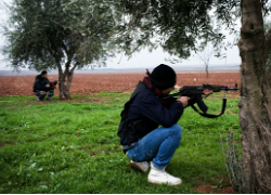 Free Syrian Army fighters aim their weapons, close to a military base, near Azaz, Syria. (Fox News)