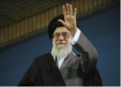 Supreme Leader Ayatollah Ali Khamenei waves to the crowd at the conclusion of his speech in Tehran, Iran. (Washington Post)