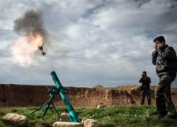 Syria rebels fire a mortar toward a regime position near Aleppo. (NOW.)