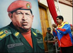 Venezuela Vice President Nicolas Maduro cheers a portrait of Chavez. (NBC Latino)