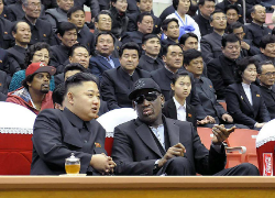 Dennis Rodman and Kim Jong-un talk Basketball Diplomacy court-side. (The Sun)