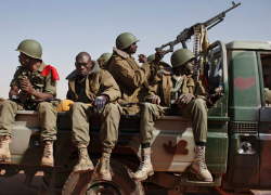 Malian soldiers arrive in the recently liberated town of Douentza. (The Guardian)