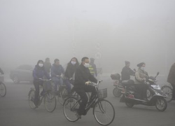 Northern China smog shuts down roads, schools, and airlines. Source: Reuters