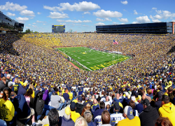 The Michigan Stadium holds 100,000+ people. Image Source: Wikipedia