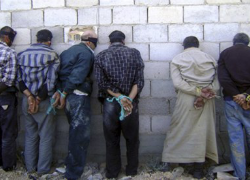 Detained Syrian men, blindfolded and handcuffed, in Qusair, near Homs. Photograph: Sana/Reuters.