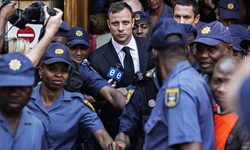 Oscar Pistorius leaves high court in Pretoria September 12, 2014 following the verdict.