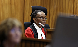 Judge Masipa delivers her judgment in the Oscar Pistorius murder trial. Image Source: Reuters.