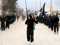 ISIL fighters marching in Raqqa, Syria.