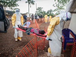 Doctors bring a suspected Ebola patient to an Ebola treatment center in Sierra Leone.