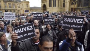"Protesters hold signs reading ""Save Serge Atlaoui"" at a rally in eastern France Saturday. (AFP Poto/Alexandre Marchi) http://news.yahoo.com/photos/protesters-hold-signs-reading-save-serge-atlaoui-april-photo-211646816.html"