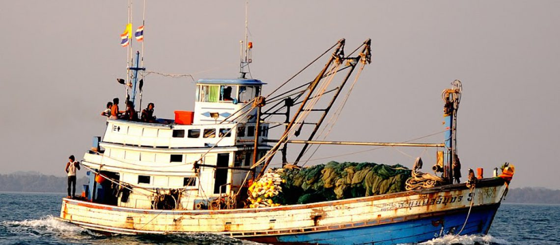 A Thai fishing boat along Koh Samet, an island in the country's eastern seaboard. Source: Mongabay, Lies, Deceit And Abduction Staff Thailand's Fishing Industry. Photographer: Philippe Gabriel.