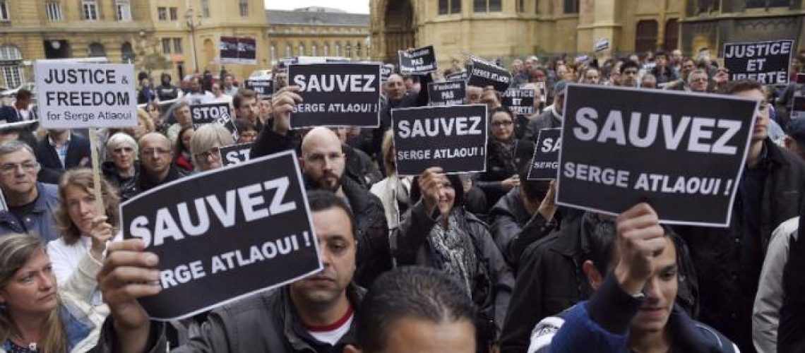 """Protesters hold signs reading """"Save Serge Atlaoui"""" at a rally in eastern France Saturday. (AFP Poto/Alexandre Marchi) http://news.yahoo.com/photos/protesters-hold-signs-reading-save-serge-atlaoui-april-photo-211646816.html"""