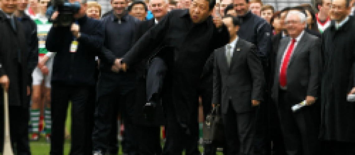 Xi JinPing kicks a Gaelic football during a February visit to Ireland. (Wall Street Journal)