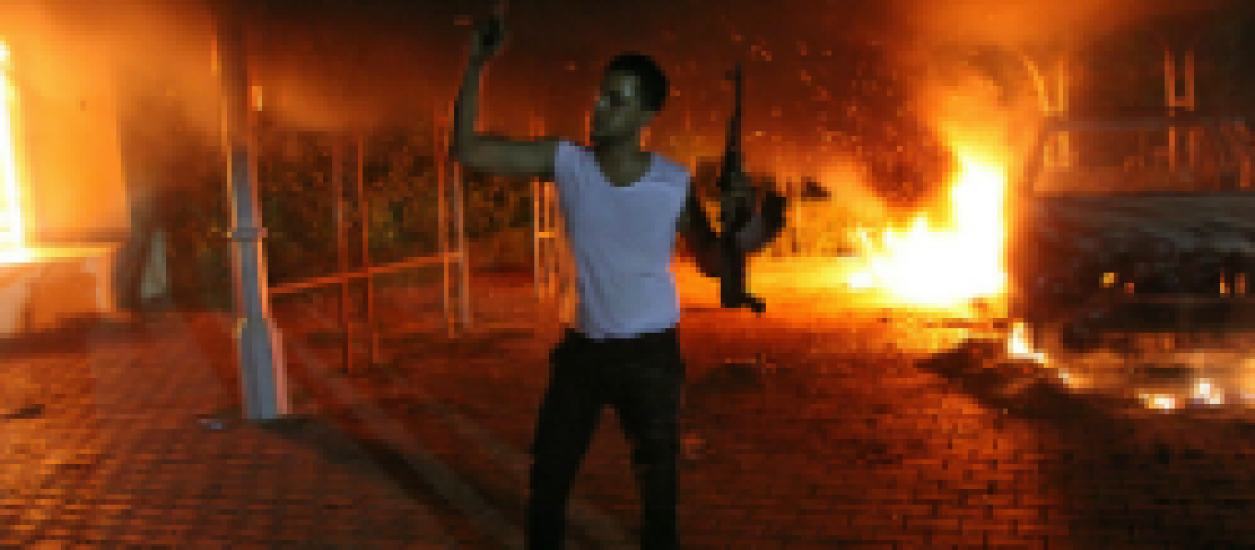 A Libyan protestor waves outside the U.S. consulate compound. http://www.huffingtonpost.com/2012/09/12/libya-consulate-attack_n_1878798.html#slide=1508286