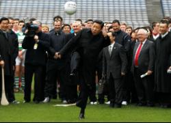 Xi JinPing kicks a Gaelic football during a February visit to Ireland. (Wall Street Journal)